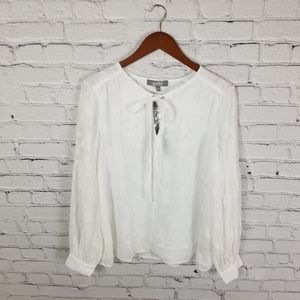 Marled white embroidered long sleeved top